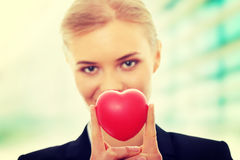 Young business woman holding heart stock photo