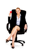 Young business woman holding heart toy Stock Photo
