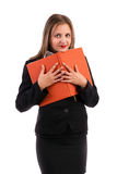 Young business woman holding her agenda. Isolated on white background Stock Photography