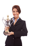 Young business woman holding her big trophy Stock Photography