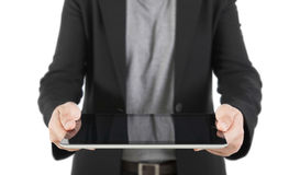 A young business woman holding her digital tablet pc (Focus on th Royalty Free Stock Images