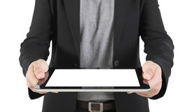 A young business woman holding her digital tablet pc (Focus on th Royalty Free Stock Photo