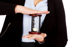 Young business woman holding hourglass-time concept Royalty Free Stock Photo