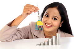 Young Business woman holding house shape key Stock Photo