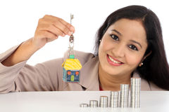 Young Business woman holding house shape key Stock Photos