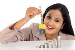 Young Business woman holding house shape key Stock Images