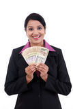 Young business woman holding Indian currency notes Stock Photos