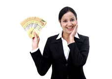 Young business woman holding Indian currency notes. Happy young business woman holding Indian currency notes Royalty Free Stock Image