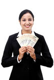 Young business woman holding Indian currency notes. Happy young business woman holding Indian currency notes against white Royalty Free Stock Images
