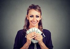 Young business woman holding money dollar banknotes Stock Photos