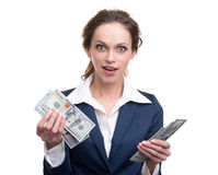 Young business woman holding money. Isolated over white Royalty Free Stock Image