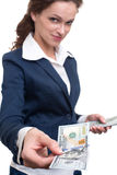 Young business woman holding money. Isolated over white Royalty Free Stock Photo