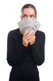 Young business woman holding money. Isolated on white Royalty Free Stock Photo