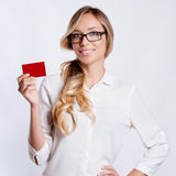 A young business woman holding new credit card Royalty Free Stock Images