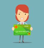 Young business woman holding new credit card Stock Photography