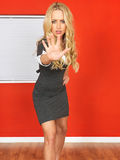 Young Business Woman Holding Out Hand to Prevent and Stop. A DSLR royalty free image, of an attractive young business woman, with blonde wavy hair, standing Stock Photography