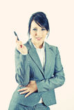 Young business woman holding a pen Royalty Free Stock Photography