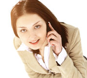 Young business woman holding phone looking up and smiling Royalty Free Stock Photography