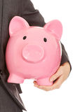 Young business woman holding piggybank Stock Photography