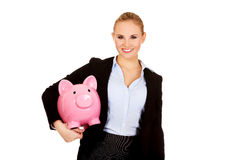 Young business woman holding  piggybank Royalty Free Stock Photography