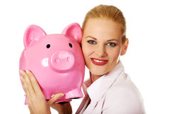 Young business woman holding piggybank Royalty Free Stock Image