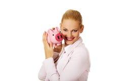 Young business woman holding piggybank Stock Photos