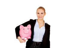 Young business woman holding  piggybank Royalty Free Stock Images