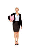 Young business woman holding  piggybank Royalty Free Stock Photo