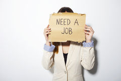 Young business woman holding a poster that says need a job Royalty Free Stock Images