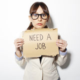 Young business woman holding a poster that says need a job Stock Images