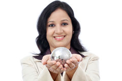 Young business woman holding puzzle globe Royalty Free Stock Photos
