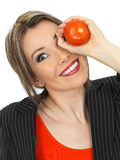 Young Business Woman Holding a Raw Tomato Stock Photography