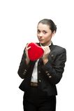 Young business woman holding red heart Stock Photo