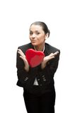 Young business woman holding red heart Stock Photography