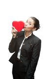 Young business woman holding red heart Stock Images