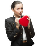Young business woman holding red heart Royalty Free Stock Photography