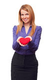 Young business woman holding red heart and smiling Royalty Free Stock Image