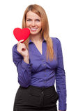Young business woman holding red heart and smiling Stock Photo
