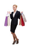 Young business woman in holding shopping bags Stock Images