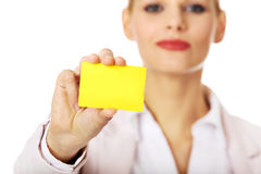 Young business woman holding small empty paper card Royalty Free Stock Photo