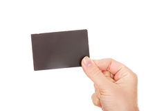 Young business woman holding small empty paper card Royalty Free Stock Photography