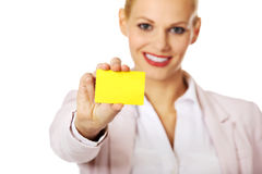 Young business woman holding small empty paper card Stock Photo