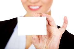 Young business woman holding small empty paper card Royalty Free Stock Images