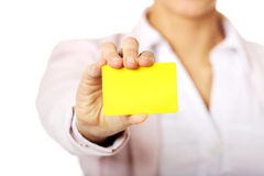 Young business woman holding small empty paper card Stock Images