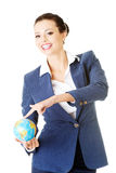 Young business woman holding small globe. Stock Photography