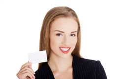 Young business woman holding small personal card. Royalty Free Stock Photos