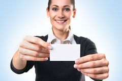 A young business woman holding a visit card Royalty Free Stock Image