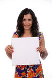Young business woman holding white card Royalty Free Stock Image