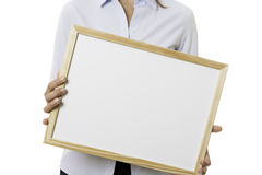 Young business woman holding a whiteboard Royalty Free Stock Photo