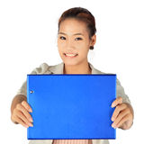 Young business Woman holds a blue folder. Royalty Free Stock Image
